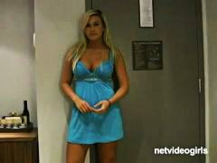 Busty blonde minx in d...