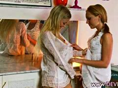 Blonde girls examining...