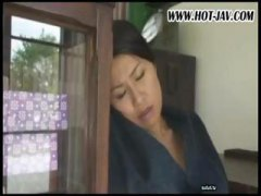 Japanese wife sucks on...
