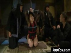 Tied up Asian slave ge...