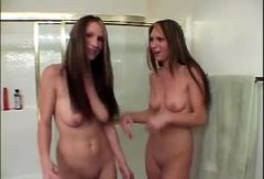 Twin girls take a bath...