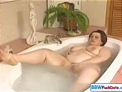 Fat girl plays with he...