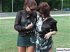 Two lesbians are outsi...