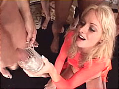 Blond girl drinks a lo...