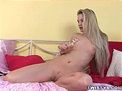 Sexy blonde playing in...