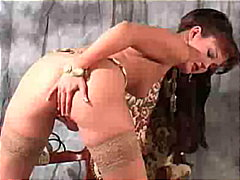 Buxom brunette seducing