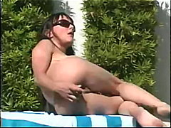 Toying her pussy outdo...