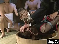Two Asian slaves get t...