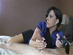 Mom gives handjob to g...