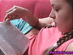Cute teen is reading a...