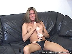 Rubbing a huge dildo b...