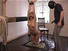 Tied up slave gets the...