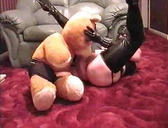MISS RUBBER GETS TEDDY...