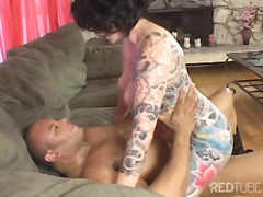 Tattooed MILF torn apa...