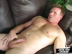 Mature guy plays with ...