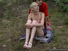 Blonde teen polishes p...