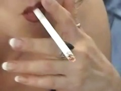Brunette slut smokes a...