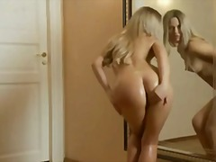 Oiled blonde plays wit...