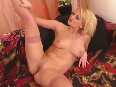 Horny blonde strips an...
