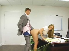 Blonde secretary bent ove...