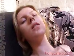 Blonde using dildo and...
