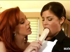 Redhead milf gives les...