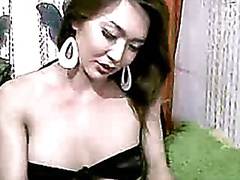 Asian Tranny plays wit...