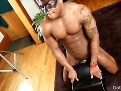 Black stud fucking a toy