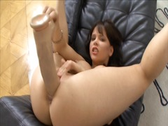 Brunette fucks herself...