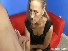 Mature woman jerks a h... from PornHub