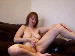 Busty old woman rubs h...
