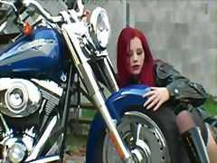 Red-haired biker in ex...