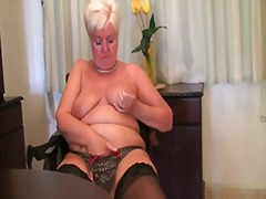 Chubby granny in black... from PornHub