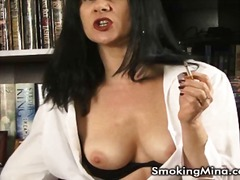 Sexy brunette smoking ... from PornerBros