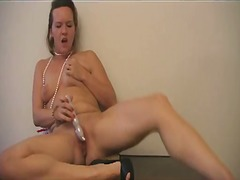 Plump slut slams toy w...