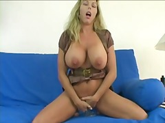 Amber uses a big dildo...