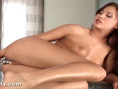 Wet dildo fucks her ba...