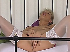 Milf rubbing her clit