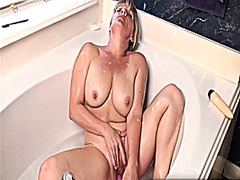 Blonde milf takes a ba...