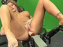 Busty blonde spreads h...