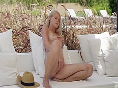 Blonde woman rubbing p...