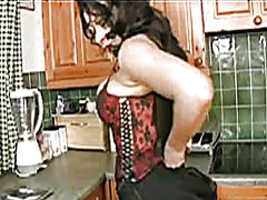 Milf plays with her bi...