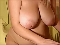 Big blonde plays with ...