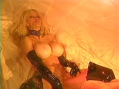 Busty chick in leather... from Xhamster