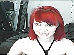 Pretty redhead plays o...