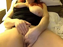 Redhead milf with tits...